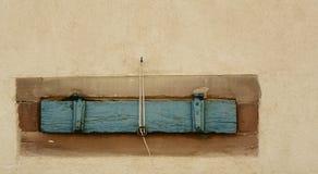 Немногое зеленая штарка складчатости бежевого дома Стоковые Изображения