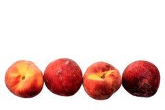 Немного зрелых персиков изолированных на белой предпосылке Стоковые Изображения RF