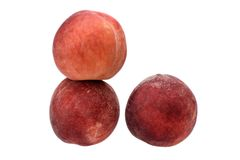 Немного зрелых персиков изолированных на белой предпосылке Стоковые Фото