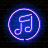 Неоновое примечание музыки на кирпичной стене Стоковая Фотография