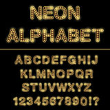 Неоновые письма алфавита изолированные на черной предпосылке Стоковые Фото