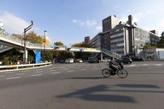 Неопознанный велосипед катания человека на улице около Harajuku Стоковое фото RF