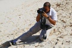 Неопознанный фотограф от курорта и казино Royalton все включено на Bavaro приставает к берегу Стоковое Фото