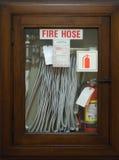 непредвиденный пожарный рукав Стоковые Изображения RF