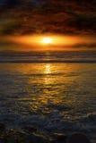 Нереальный заход солнца от beal пляжа Стоковые Изображения