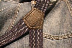 несенная старая джинсыов Стоковое Фото