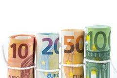 Несколько кренов банкнот евро штабелированных значением от 10, twent Стоковое Изображение