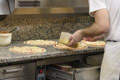 Несколько частей пиццы на таблице Стоковые Изображения RF