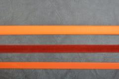 Несколько поясов на серой предпосылке Стоковое Изображение RF