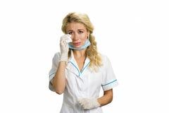 Несчастная плача медсестра детенышей Стоковая Фотография