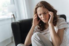 Несчастная унылая женщина имея мигрень Стоковое Изображение RF