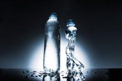 Нетронутые и скомканные бутылки воды Стоковое Изображение RF