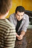 Неуверенный молодой человек Стоковая Фотография RF