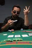 неудовлетворенная сторона его показ покера игрока Стоковые Фото
