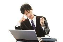 Неудовлетворенный азиатский бизнесмен Стоковая Фотография RF
