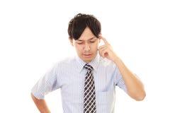 Неудовлетворенный азиатский бизнесмен Стоковое Изображение RF