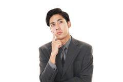 Неудовлетворенный азиатский бизнесмен Стоковое Фото