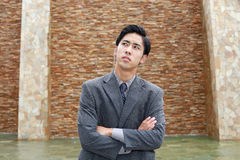 Неудовлетворенный азиатский бизнесмен Стоковые Фото