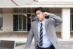 Неудовлетворенный азиатский бизнесмен Стоковая Фотография
