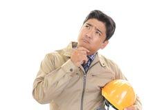 Неудовлетворенный азиатский работник стоковые изображения