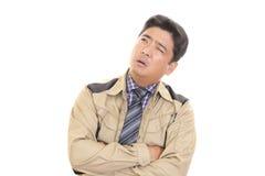 Неудовлетворенный азиатский работник стоковые фото