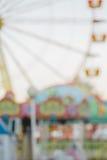 Неясное изображение парка атракционов, предпосылка Стоковая Фотография RF