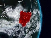 Нигерия от космоса на ноче стоковые фотографии rf