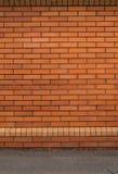 нижний желтый цвет стены верхней части текстуры коричневого цвета кирпича Стоковое фото RF