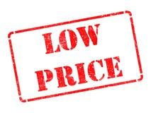 Низкая цена - надпись на красной избитой фразе. стоковое изображение rf