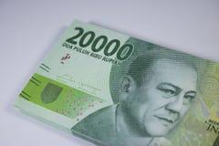 Новая оплата финансов наличных денег валюты Индонезии денег две тысячи рупий Стоковые Изображения RF