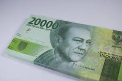Новая оплата финансов наличных денег валюты Индонезии денег две тысячи рупий Стоковые Фото