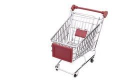 Новая пустая красная магазинная тележкаа изолированная на белой предпосылке Стоковые Фото