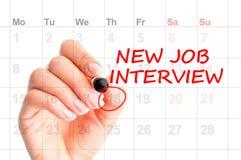 Новое напоминание собеседования для приема на работу на календаре Стоковые Изображения RF