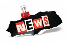 Новости в бумажном зажиме Стоковые Фото