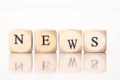 Новости, сказанные по буквам с письмами кости Стоковое Фото