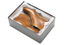 Новые коричневые ботинки в коробке Стоковые Изображения RF