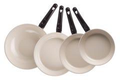 Новые лотки кухни изолированные на белой предпосылке Стоковая Фотография RF