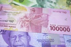 новые финансы наличных денег валюты Индонезии денег рупии Стоковые Фотографии RF