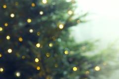 Новый Год или рождество запачкали предпосылку с рождественской елкой и стоковое изображение