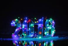 Новый Год 2018 Номер загорен гирляндой стоковое фото rf