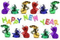 Новый Год lollies приветствиям шоколада Стоковые Изображения RF