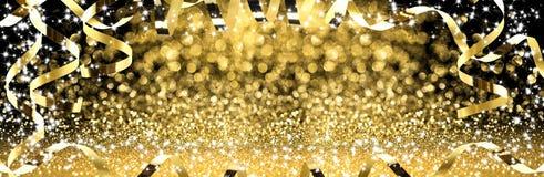 Новый Год, золотые ленты с сверкная ярким блеском стоковая фотография