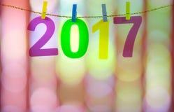 Новый Год 2017 номеров на красочном запачканном свете Стоковые Фотографии RF