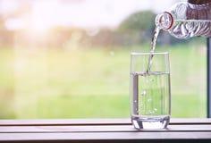 Новый день с стеклом воды стоковая фотография