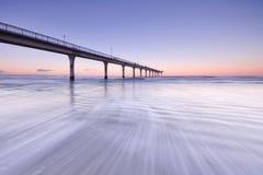 Новый заход солнца пристани Брайтона, Крайстчёрч Стоковые Фотографии RF