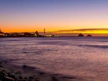 Новый заход солнца Foreshore Плимута - Taranaki, Новая Зеландия Стоковая Фотография