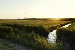Новый маяк в Wangerooge на заходе солнца Стоковая Фотография RF