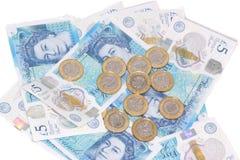 Новый полимер Великобритании примечание 5 фунтов и новые 12 встал на сторону монетка £1 Стоковая Фотография