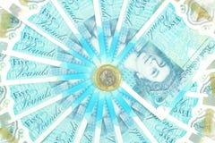 Новый полимер Великобритании примечание 5 фунтов и новые 12 встал на сторону монетка £1 Стоковое Фото