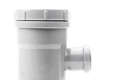 Новый серый тройник водоотводной трубы на белизне Стоковая Фотография RF